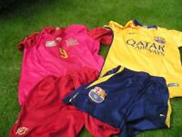2 x kids football kits - Away Barcelona and Spain 10 -13/14 yrs great condition.
