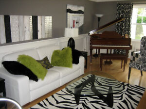 Stunning pure wool black and cream patterned rug- modern