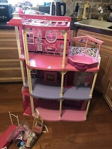 Barbie house and vehicle lot