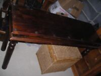 solid dark wood rectangular table with metal studs to surface 4 solid round legs
