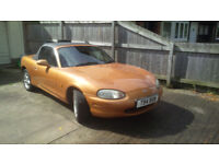 Mazda MX5 with both rear wings replaced, only 64500 miles