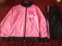 Girls pink and navy tracksuit age 8