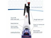 Bissell Carpet cleaner with Cleaning solution.