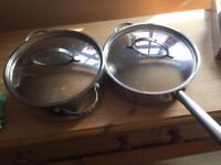 One Meyer Large stainless steel sauce pan and one Large Meyer stainless steel frying pan