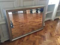 Large ornate antique silver mirror