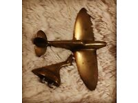 Small brass spitfire on a stand