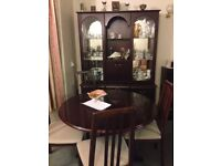Dining table and 4 chairs. Also sideboard & glass cupboard