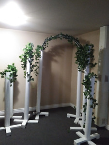 Arch and pillars with ivy garland