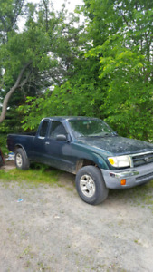 98 Toyota Tacoma 4x4, trade for a 4 wheeler
