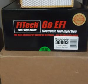 FiTech EFI !!! get rid of that old carburetor.
