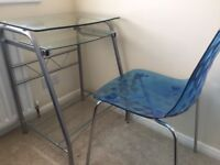 Metal and glass desk with stylish chair