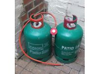 For sale. 2 13kg patio gas bottles. 1 full. 1 empty. Regulator also included. £45