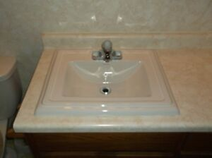 newer white sink with tap.