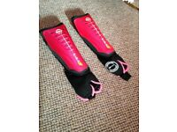 Hockey shin guards. Size small. Pink. Never used.