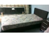 Single Bed complete with mattress. Dark brown leather look bed in very good condition.