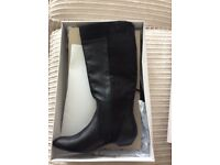 Black long boots brand new in size 6