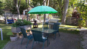 Glass/Metal Patio Table with 4 chairs and umbrella