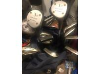 Golf clubs. Regal pro orbit irons and old woods and putter