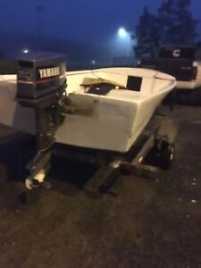 14 foot fiberglass boat with 20 hp Yamaha