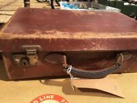 Beautiful scuffed brown vintage mini suitcase