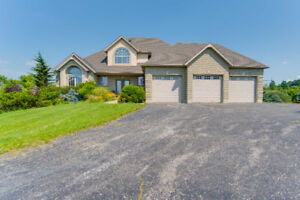 Gorgeous 3+1 bedroom, 3.5 bathroom country home with walk-out