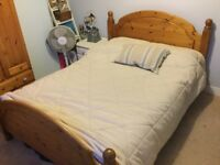 Solid pine double bed with (or without) mattress. Good condition from a smoke free and pet free home