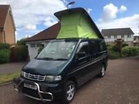 Mazda bongo camper van professional conversion full side kitchen rock roller bed 4wd 4 berth