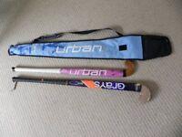 Two teeenager's hockey sticks