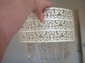 A pieced metal and plastic beads lampshade.