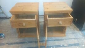 A pair of pine beside cupboards/cabinets