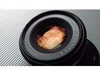 50 mm f/1.8 nikon E lens.