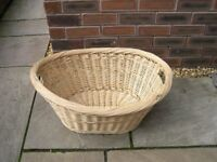 A large wicker laundry basket.