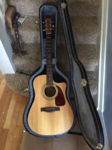 Fender Electric Acoustic Guitar and hard case.
