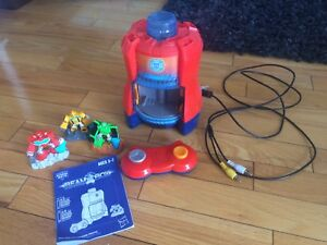 Rescue Bots Beam Box and three game figures