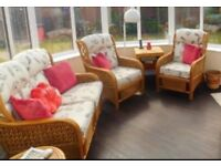 Great condition solid cane comfortable furniture. 2 seater 2 chairs