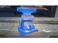 NEW BENCH VICE 5 INCH WIDE JAWS SWIVEL BASE WITH 3 BOLT HOLES.