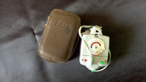 Vintage Ricoh flash and leather case