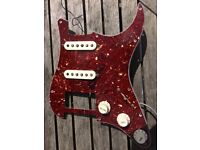 Fender Eric Clapton mid boost circuit with two single coil pickups and scratch plate