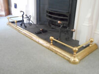 Brass fire surround and fire dogs and tools.