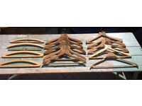 Assortment of vintage and modern wooden coat hangers.