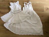 2 girls white summer dresses. Hardly worn. Aged 8/9 years