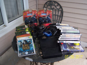 Playstation 2 plus  console,games and controllers