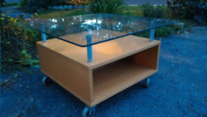 Small coffee table on wheels with glass top