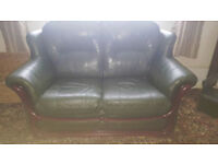 2 seater and 2 single chairs dark green leather dark wood