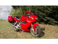 2001 Ducati st4. Low milege, great condition, corbin seat, staintune cans, ohlins suspension.