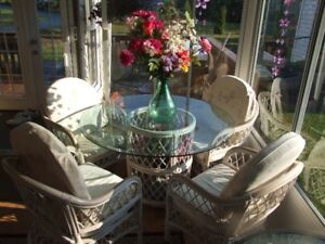 Wicker glass top table and 4 chairs.