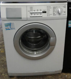 O628 white aeg 8kg 1400spin washing machine comes with warranty can be delivered or collected