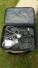 Laptop bag and various chargers and adaptors