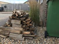 Large pile of fire wood for wood burners or open fires. The wood is clean and all cut up.
