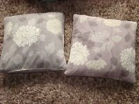 2 cushions from dunelm, lovely brown/mink/cream flower pattern. zipped. £3.00. Torquay